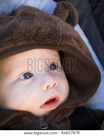 Baby in bear outfit