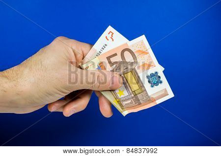 Hand Holding Out A Banknote