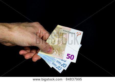 Hand Holding Out Some Banknotes