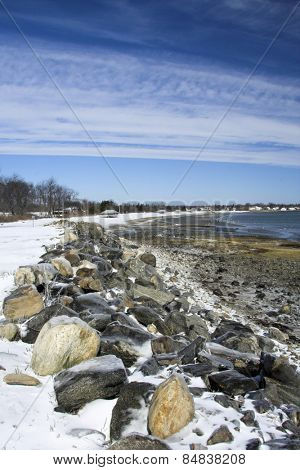 Scenic beach in winter with blue sky