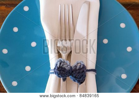 Table Decoration: White Plate Serviette Fork Knife With Handmade Crochet Bowl On Blue Plate