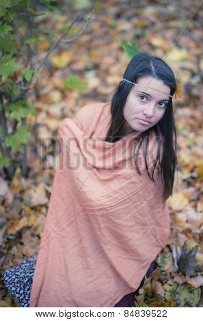 Solitude Concept. Sad Lonely Woman Relaxing In Romantic Autumn Forest Park Outdoor