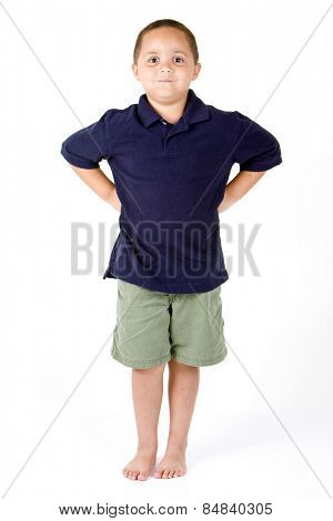 Happy mixed race boy with hands on hips on white background