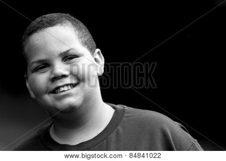 Portrait of a smiling boy outside