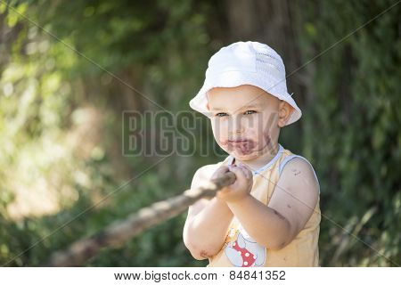 Child Dirty Mouth By Mulberries With A Stick In Hand