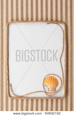 Beautiful Frame Of Rope And Sea Shells With A White Background On The Sand