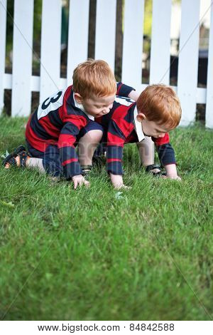 Twin baby boys playing outside