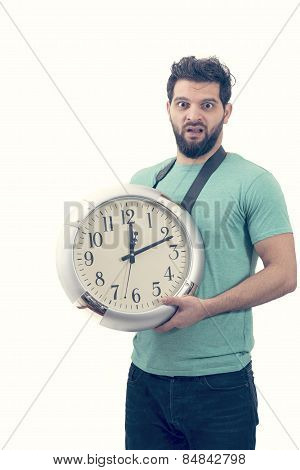 Portret Of An Unhappy Male Holding Big Clock Running Out Of Time Isolated On White Background