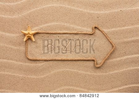 Arrow Made Of Rope And Sea Shells With The Word Ibiza On The Sand