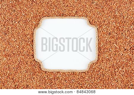 Figured Frame Made Of Rope With  Buckwheat  Grains  Lying On A White Background