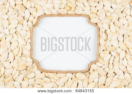 Figured Frame Made Of Rope With  Pumpkin Seeds  Lying On A White Background