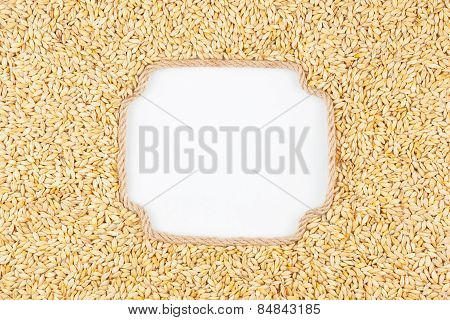 Figured Frame Made Of Rope With  Barley  Grains  Lying On A White Background
