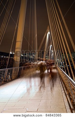 Millennium bridge in London with blurred motion walkers