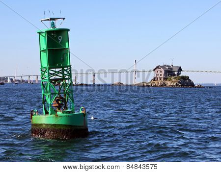 Newport Bridge in Rhode Island with buoy in foreground and Clingstone House