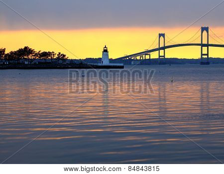 Beautiful sunset over Claiborne Pell Bridge and lighthouse in Newport, Rhode Island