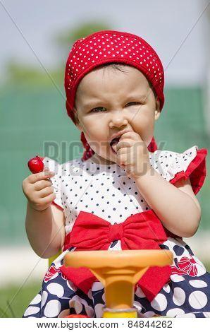 Toddler Eating Cherries