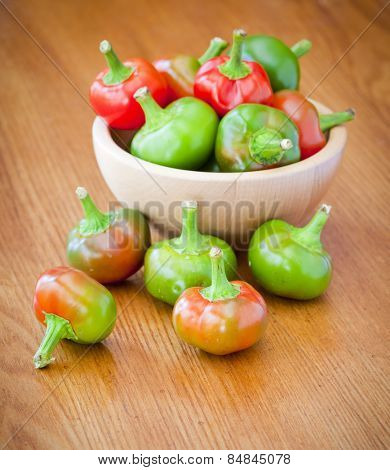 Hot cherry peppers in a bowl on a table