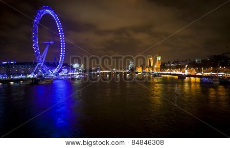 LONDON, ENGLAND FEB 17:  London eye at night with Westminster Bridge and Parliament on Feb 17, 2012 in London, United Kingdom.