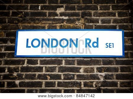 Old dirty London Road sign in Southwick, London, England