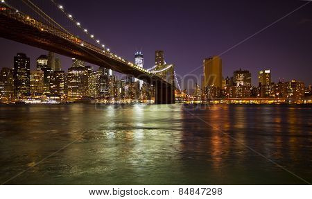 Lower Manhattan and Brooklyn Bridge in New York at nighttime