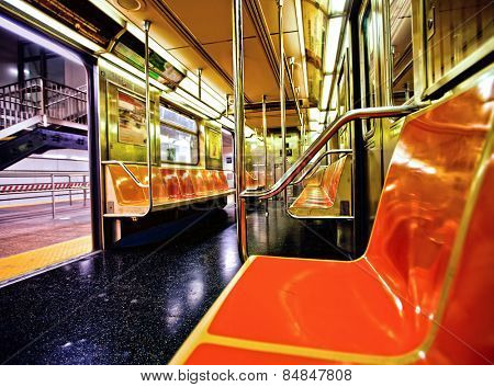 New York subway car interior with open door