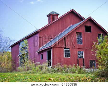 Old abandoned red barn in the fall