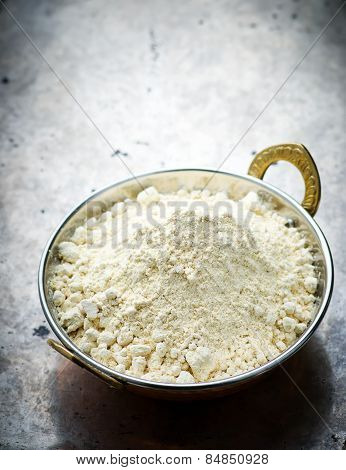 Flour From Chick-pea In The Indian Copper Bowl