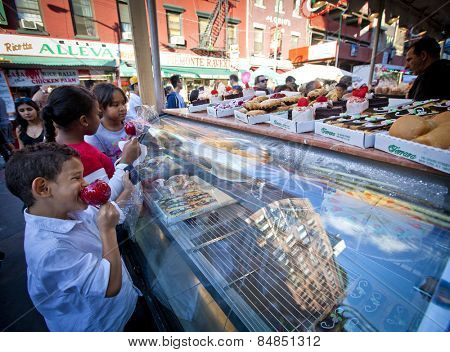 NEW YORK, NY - SEPT 22: Little Italy on Mulberry St. during the Feast Of San Gennaro on September 22, 2013 in New York City.