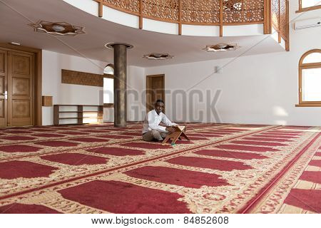 African Muslim Man Is Reading The Koran