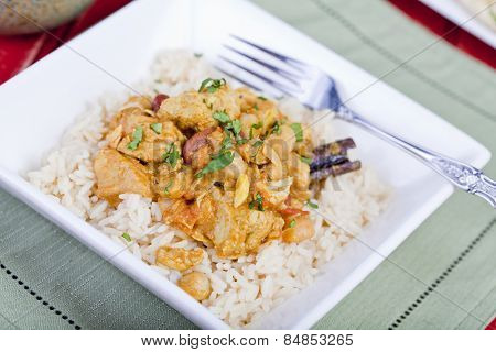 Chicken curry served on a bed of rice