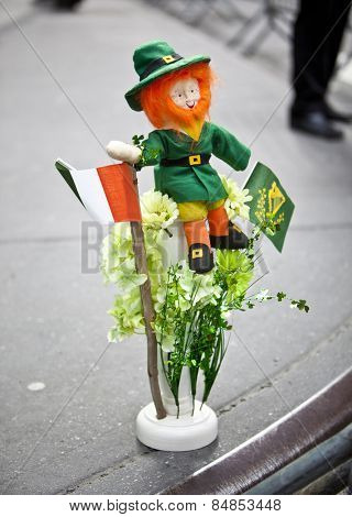NEW YORK, NY, USA - MAR 17: Leprechaun on sidewalk at St. Patrick's Day Parade on March 17, 2013 in New York City, United States.