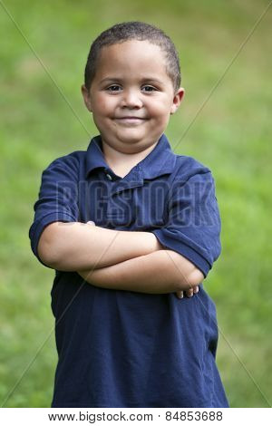Happy latino boy close-up portrait outdoors