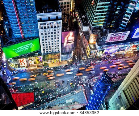 NEW YORK, USA - JUNE 29th, 2014: Aerial view of Times Square the popular New Year's Eve destination with crowds and taxi cabs in motion in New York City