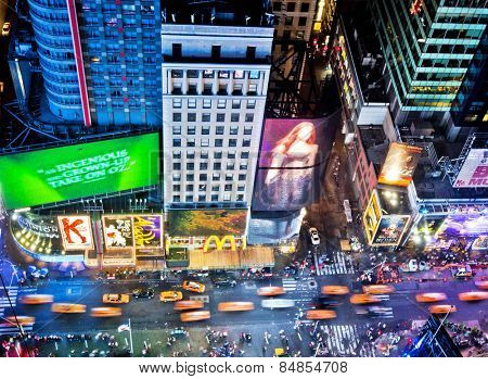 NEW YORK, USA - JUNE 29, 2014: Aerial view of Times Square the popular New Year's Eve destination with crowds and taxi cabs in motion in New York City.