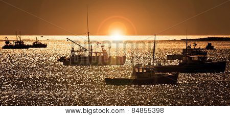 Lobster fishing vessels at sunset in Maine, New England