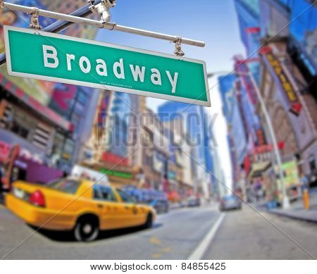 Colorful Broadway sign over Times Square background
