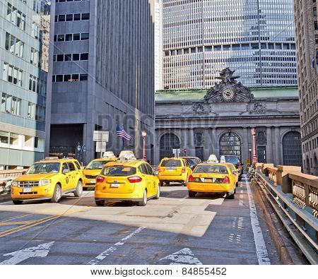 NEW YORK, USA - NOVEMBER 13th, 2014: Yellow taxi cabs outside the front entrance to Grand Central Terminal train station.
