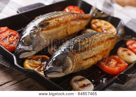 Delicious Grilled Sea Fish And Vegetables In A Pan Grill