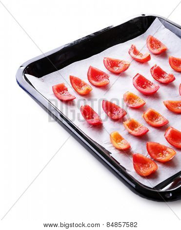 Tomatoes on drying tray, isolated on white