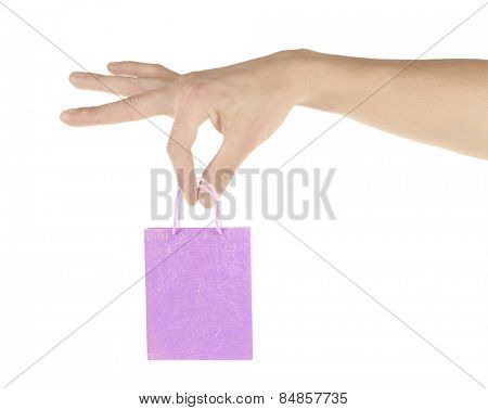 Small paper bag in big hand isolated on white