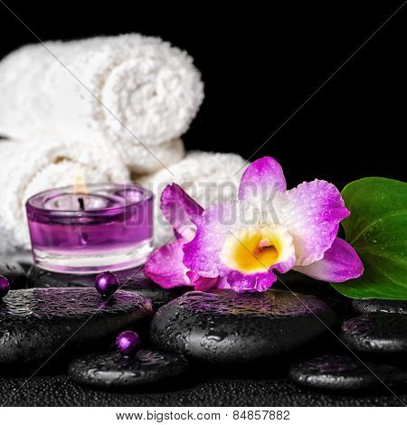 Spa Concept Of Orchid Flower, Zen Basalt Stones With Drops, Purple Candles, Beads And White Towels,