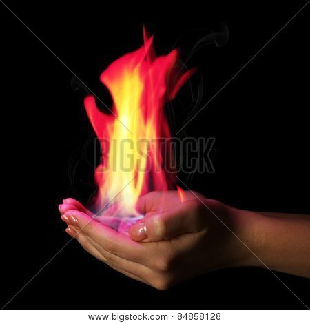 Hands with fire isolated on black
