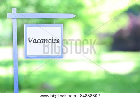 Signboard with text Vacancies near hotel