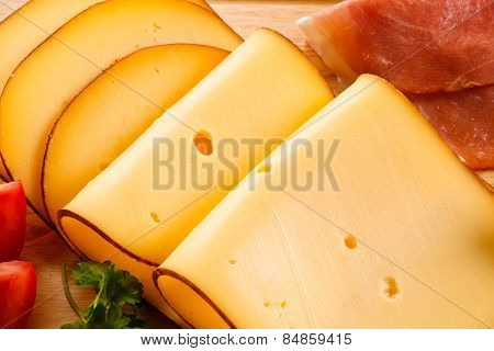 Cheese on cutting board on white background