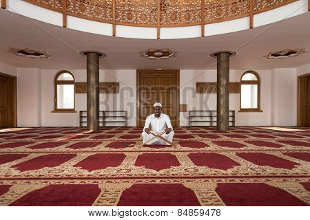 African Muslim Man Reading Holy Islamic Book Koran