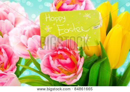 Easter bouquet of spring flowers with greeting card. Spring Flowers bunch. Beautiful colourful Tulips bouquet. Elegant Easter gift. Springtime. Beautiful Easter background