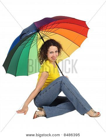 Young Attractive Woman In Yellow Shirt With Multicolored Umbrella Sitting Isolated On White Looking