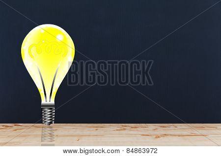 Lightbulb On Black Wall