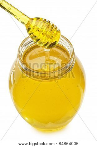 Glass With Honey And Honey Dipper Isolated On The White Background