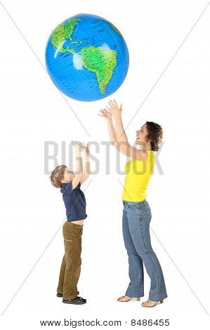 Mother And Son Throw Up Big Inflatable Globe, Side View, Isolated On White